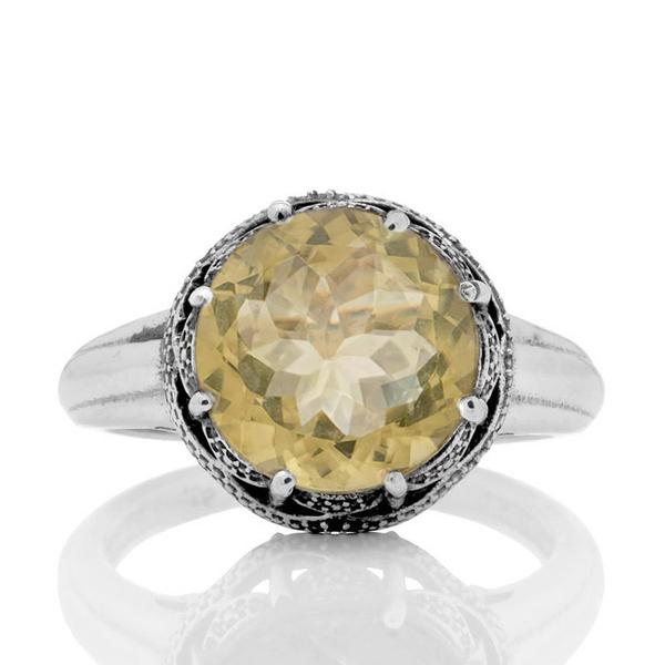 Сребърен пръстен с цитрин в орнаментиран обков