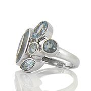 Сребърен пръстен с фасетирани сини топази
