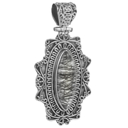 Голям сребърен медальон с турмалинов кварц в орнаментиран обков