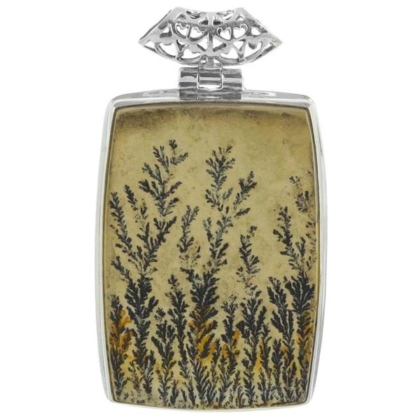 Сребърен медальон с едър дендро псиломелан