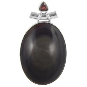 Сребърен медальон с обсидианово око и гранат