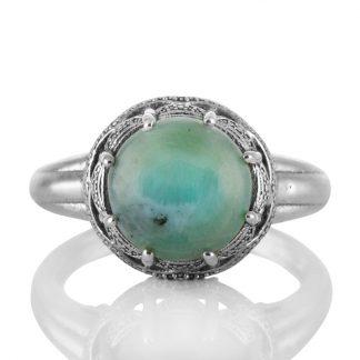 Сребърен пръстен с ларимар в орнаментиран обков