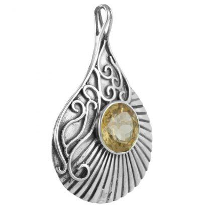 Сребърен медальон с цитрин в орнаментиран обков