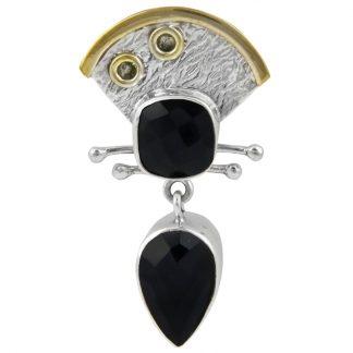 Сребърен медальон с фасетиран черен оникс