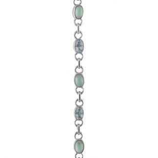 Нежна сребърна гривна с ларимари и сини топази